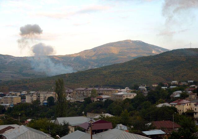 Smoke rises after an artillery strike in Stepanakert, Nagorno-Karabakh