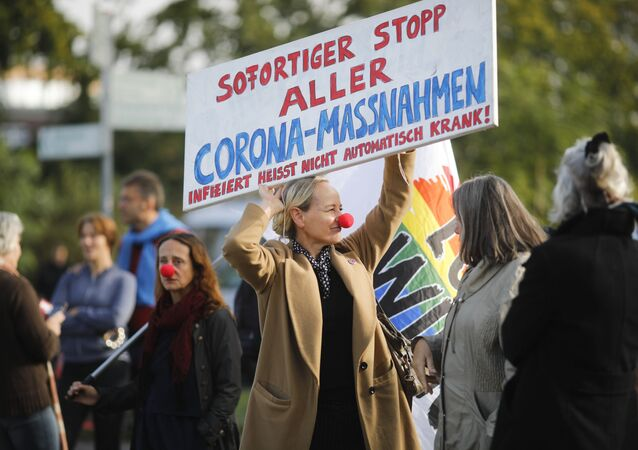 People against the government's coronavirus policy protest in front of German President's residence Bellevue Palace in Berlin, Germany, Thursday, Oct. 1, 2020.