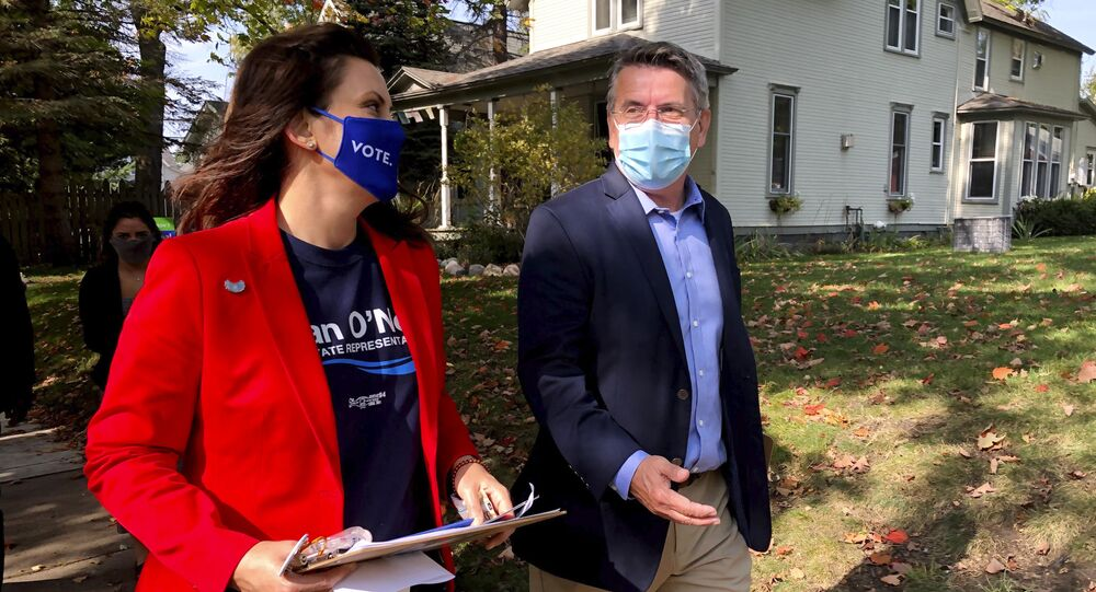 Michigan Gov. Gretchen Whitmer campaigns with Dan O'Neil, a Democratic candidate for the Michigan House in Traverse City, Mich., Friday, Oct. 9, 2020. Whitmer visited the area the day after police announced a foiled plot to kidnap the governor.