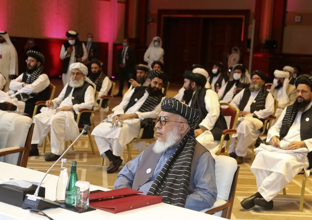 In this Sept. 12, 2020, file photo, Taliban negotiator Abbas Stanikzai, center front, and his delegation attend the opening session of peace talks between the Afghan government and the Taliban, in Doha, Qatar. Afghanistan's Taliban on Thursday, Oct. 8, 2020, welcomed a tweet from President Donald Trump in which he promised to have the last of the U.S.'s troops out of Afghanistan by Christmas. If that withdrawal happens, it would be months ahead of schedule and the tweet made no reference to a Taliban promise to fight terrorist groups — a previous pre-requisite for an American withdrawal.