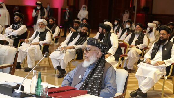 In this Sept. 12, 2020, file photo, Taliban negotiator Abbas Stanikzai, center front, and his delegation attend the opening session of peace talks between the Afghan government and the Taliban, in Doha, Qatar. Afghanistan's Taliban on Thursday, Oct. 8, 2020, welcomed a tweet from President Donald Trump in which he promised to have the last of the U.S.'s troops out of Afghanistan by Christmas. If that withdrawal happens, it would be months ahead of schedule and the tweet made no reference to a Taliban promise to fight terrorist groups — a previous pre-requisite for an American withdrawal. - Sputnik International
