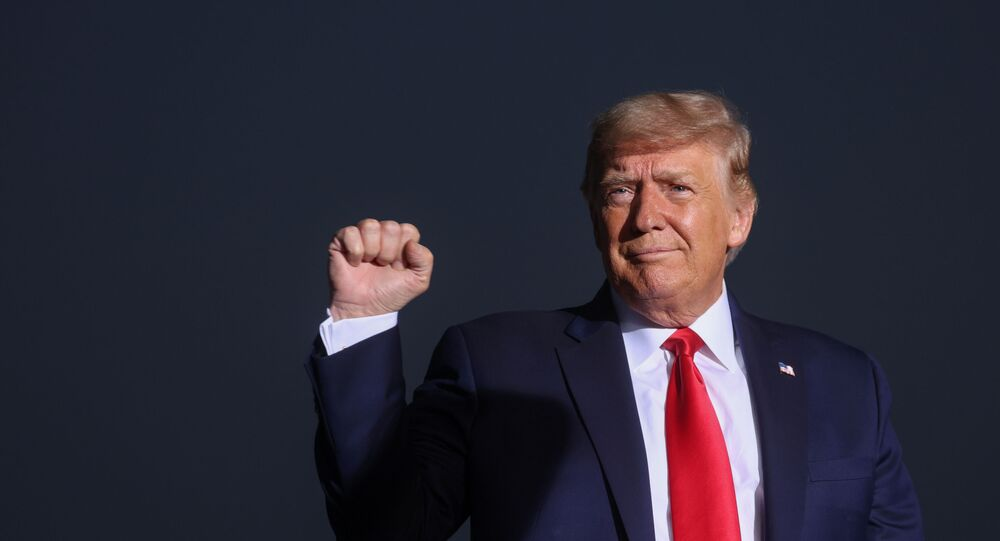 U.S. President Donald Trump pumps his fist during a campaign rally in Reno, Nevada, U.S., September 12, 2020
