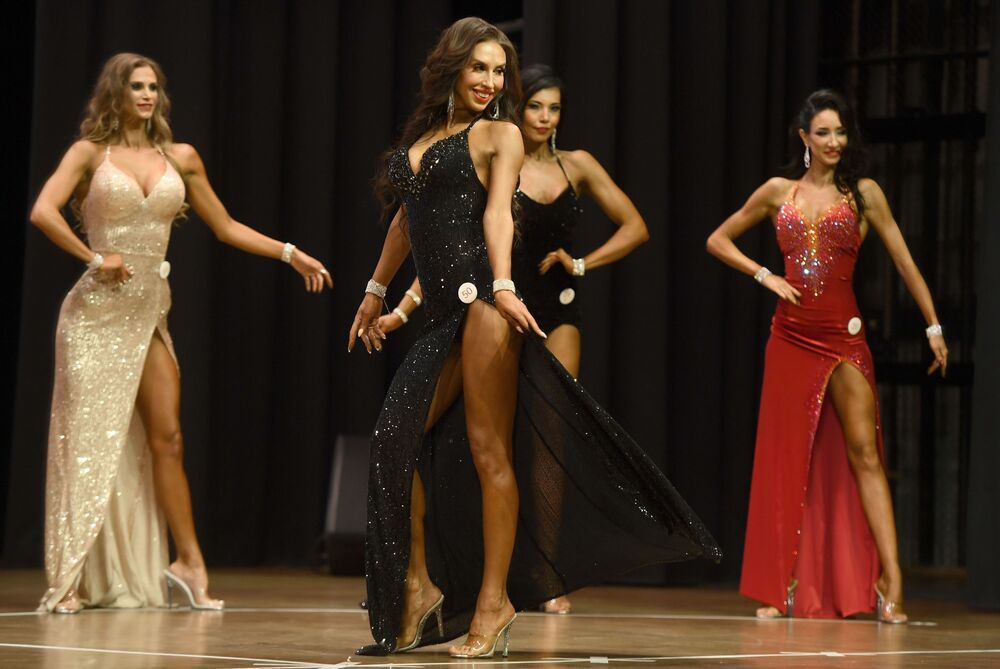 Female bodybuilders wearing dresses during the Bodybuilding Championship in Kazan