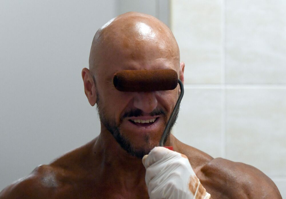 A bodybuilder is getting tanned as he prepares for a competition in Kazan