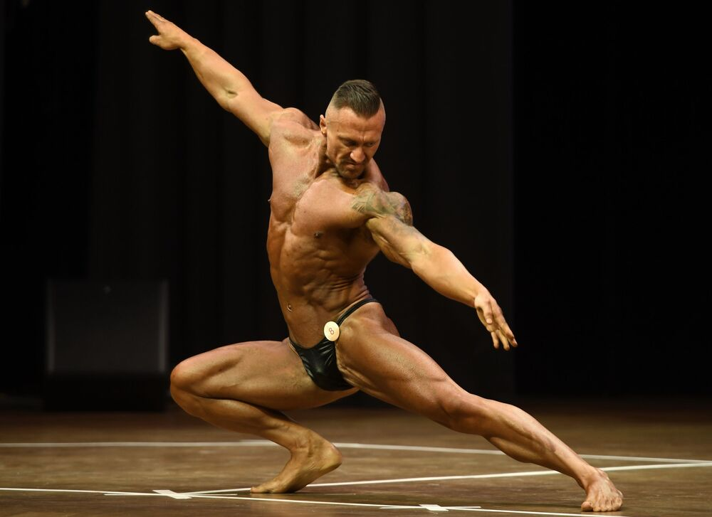 A bodybuilder performs at the championship in Kazan