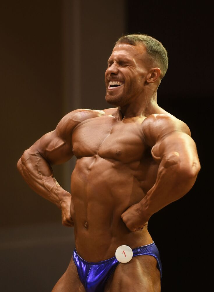 A bodybuilder reacts during a championship in Kazan