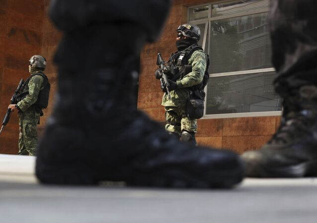 Security agents stand guard outside the apartment building where Damaso Lopez, nicknamed El Licenciado, was captured in the Anzures neighborhood of Mexico City, Tuesday, May 2, 2017. , May 2, 2017. Mexican prosecutors said they captured Lopez, one of the Sinaloa cartel leaders who launched a struggle for control of the gang following the re-arrest of Joaquin El Chapo Guzman