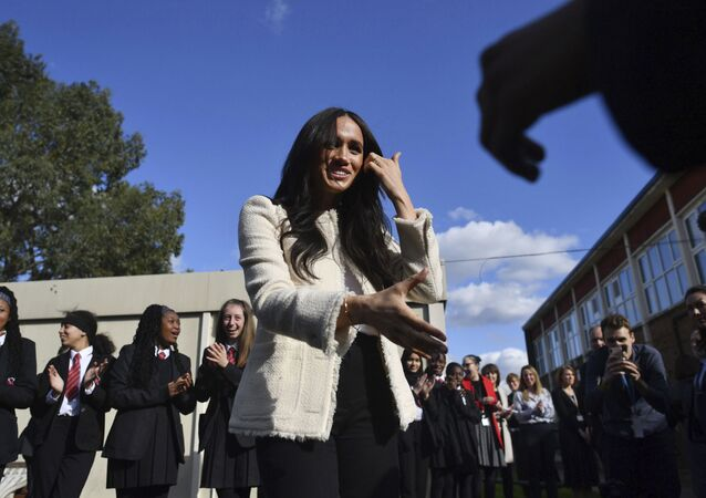 Britain's Meghan, Duchess of Sussex, is greeted by pupils at the Robert Clack Upper School in Dagenham, Essex to the east of London, during a surprise visit to celebrate International Women's Day, Friday, 6 March 2020.