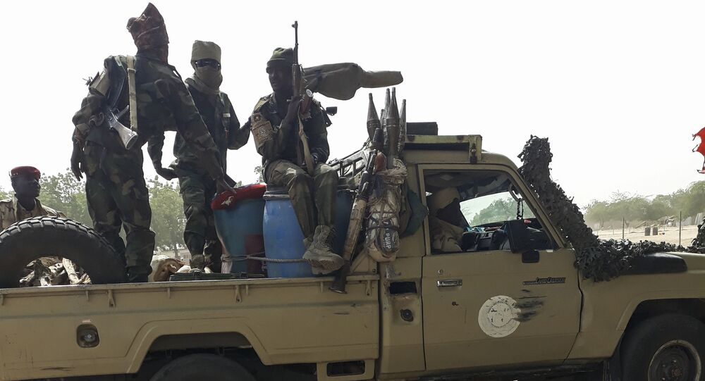 Soldiers of the Chad Army sit on the back of a Land Cruiser at the Koundoul market, 25 km from N'Djamena, on January 3, 2020, upon their return  after a months-long mission fighting Boko Haram in neighbouring Nigeria.