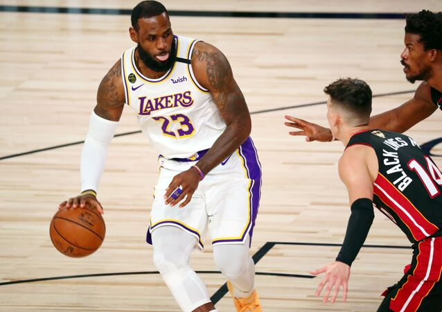 11 October 2020; Lake Buena Vista, Florida, USA; Los Angeles Lakers forward LeBron James (23) dribbles while defended by Miami Heat guard Tyler Herro (14) during the first quarter in game six of the 2020 NBA Finals at AdventHealth Arena. .