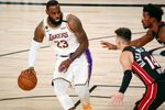 Oct 11, 2020; Lake Buena Vista, Florida, USA; Los Angeles Lakers forward LeBron James (23) dribbles while defended by Miami Heat guard Tyler Herro (14) during the first quarter in game six of the 2020 NBA Finals at AdventHealth Arena.