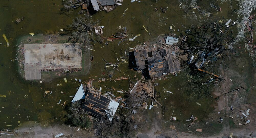 Homes and businesses destroyed by Hurricane Laura are surrounded by flood waters in the aftermath of Hurricane Delta in Cameron, Louisiana, U.S., October 10, 2020.