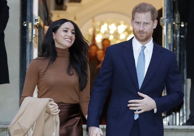Britain's Prince Harry and Meghan, Duchess of Sussex leave after visiting Canada House in London, Tuesday Jan. 7, 2020, after their recent stay in Canada