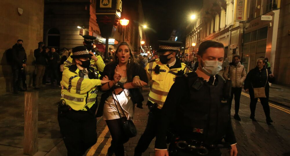 Police patrol as revellers enjoy a night out in the centre of Liverpool, north west England on October 10, 2020 ahead of new measures set to be introduced in the northwest next week to help stem the spread of the novel coronavirus