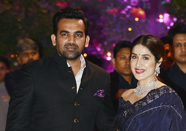 Indian Cricketer Zaheer Khan poses for a picture with his wife and actress Sagarika Ghatge as they attend the pre-engagement party of India's richest man and Reliance Industries Limited Chairman, Mukesh Ambani's eldest son Akash Ambani and fiancee Shloka Mehta, in Mumbai late on June 30, 2018