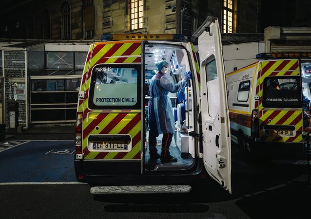 A French first aid worker from the Protection Civile Paris Seine, disinfects an ambulance (File)
