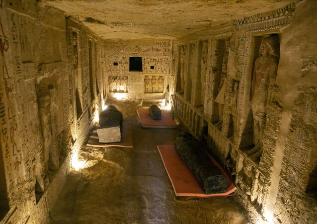 Several sarcophagi are displayed inside a tomb at the Saqqara archaeological site, 30 kilometers (19 miles) south of Cairo, Egypt, on Saturday, Oct. 3, 2020