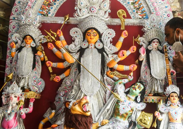 Craftsman Kaushik Ghosh gives finishing touches to a fiberglass idol of Hindu Goddess Durga before sending to the USA where it will be used for the Durga Puja festival, inside his workshop in Kolkata on June 4, 2020.