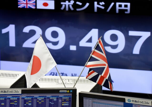 Japanese and British flags are placed in front of a monitor showing the Japanese yen rate against the British pound at a brokerage in Tokyo on October 7, 2016.