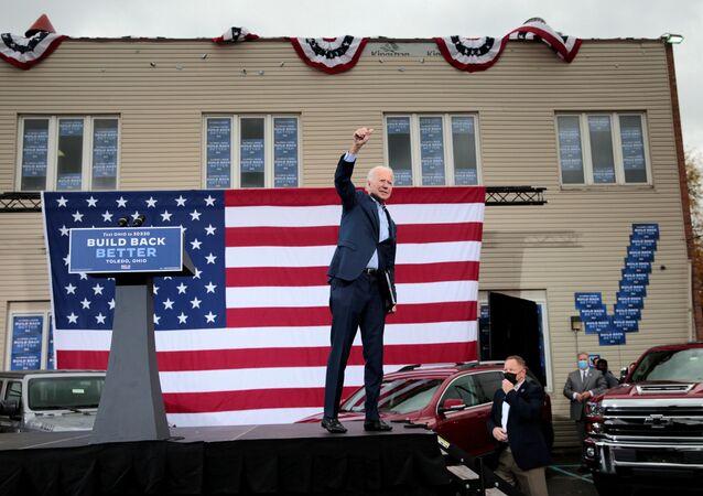 Democratic presidential candidate Joe Biden raises his arm  during a drive-in campaign event in Toledo, Ohio, U.S., October 12, 2020.