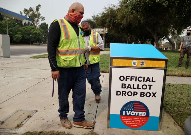 StreetsLA workers install one of 123 Vote by Mail Drop Boxes outside a public library, amid the global outbreak of the coronavirus disease (COVID-19), in Los Angeles, California, U.S., September 11, 2020.