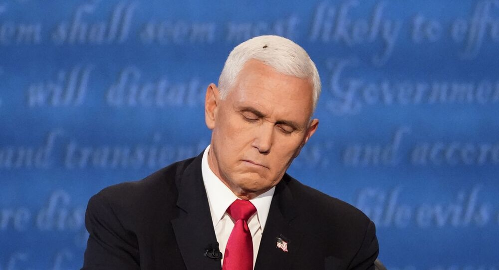 Vice President Mike Pence listens to Democratic vice presidential candidate Sen. Kamala Harris, D-Calif., during the vice presidential debate on Wednesday, 7 October 2020