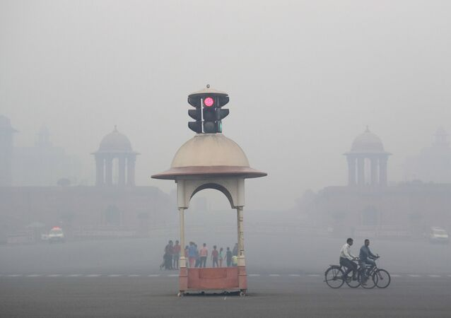 Cyclist pedals through the morning smog a day after the Diwali festival, in New Delhi, India, 20 October 2017