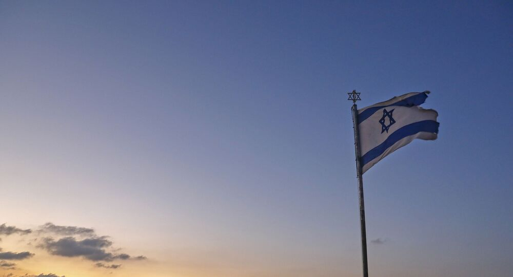 An Israeli flag flutters at the Mount of the Olives with a view of the Dome of the Rock in Jerusalem's al-Aqsa mosque compound (background) on September 23, 2020.