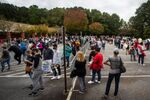 Hundreds of people wait in line for early voting on Monday, Oct. 12, 2020, in Marietta, Georgia