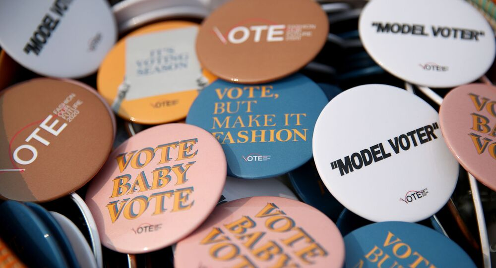 Guests pick up their voting merch and make a statement about the importance of your voice and your vote at Fashion Our Future 2020