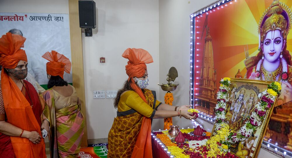 Bharatiya Janata Party (BJP) workers and leaders offer prayers to the Hindu deity Ram before the groundbreaking ceremony of the Ram Temple in Ayodhaya, in Mumbai on 5 August 2020.