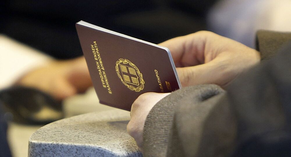 In this Wednesday, March 7, 2018 photo, a passenger shows his Greek passport at Frankfurt airport, Germany