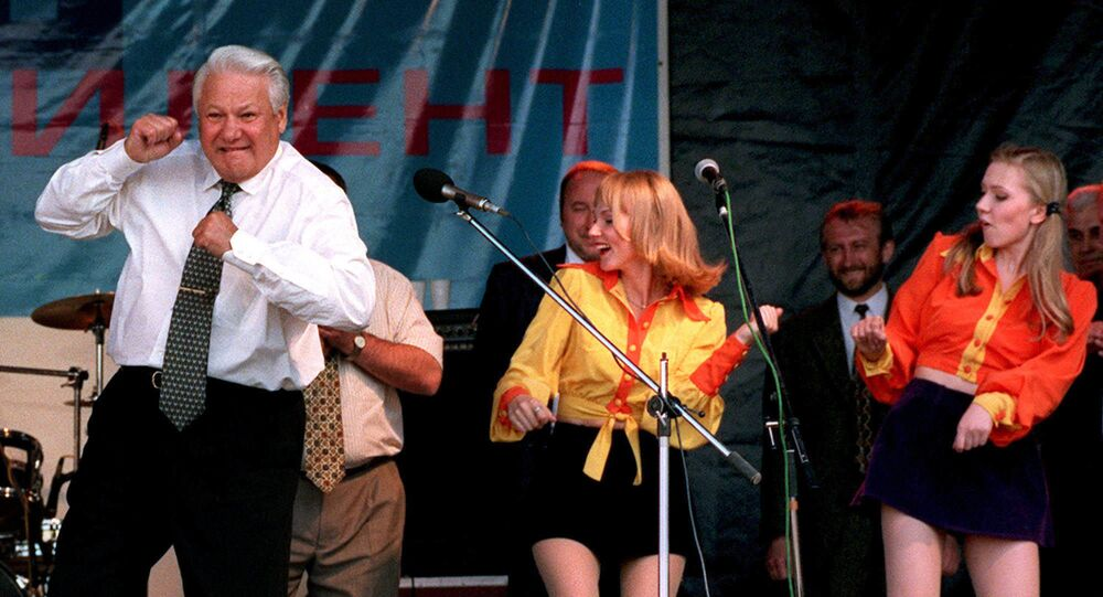 FILE - In this June 10, 1996, file photo, Russian President Boris Yeltsin dances at a rock concert after arriving in Rostov, Russia.