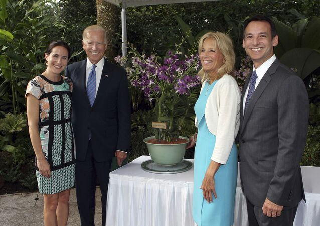 U.S. Vice President Joe Biden, second left, smiles with his wife, Jill, second right, their daughter Ashley, left, and their son-in-law Howard Krein as they stand by a newly unveiled orchid hybrid, the Dendrobium Joe and Jill Biden, named after in honor of the couple during a ceremony at the National Orchid Garden in Singapore Friday, July 26, 2013.