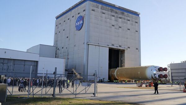 Employees and contractors watch as the core stage of NASA's Space Launch System rocket, that will be used for the Artemis 1 Mission, is rolled out of the NASA Michoud Assembly Facility where it was built, in New Orleans, Wednesday, Jan. 8, 2020. - Sputnik International