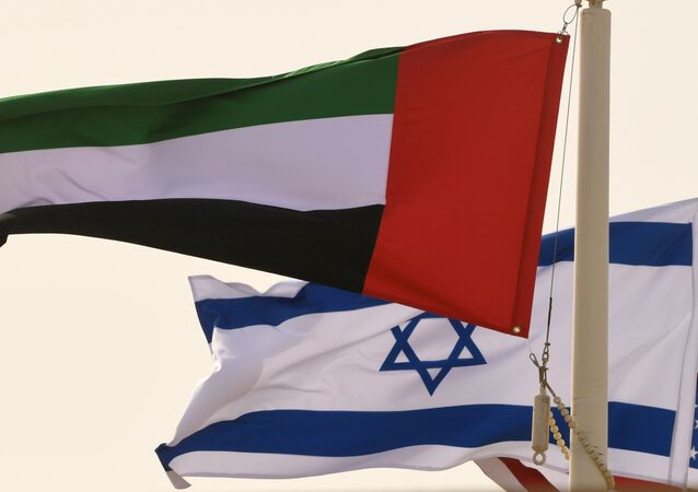 The Emirati, Israeli and US flags sway in the wind at the Abu Dhabi airport at the arrival  of the first-ever commercial flight from Israel to the UAE, on August 31, 2020.