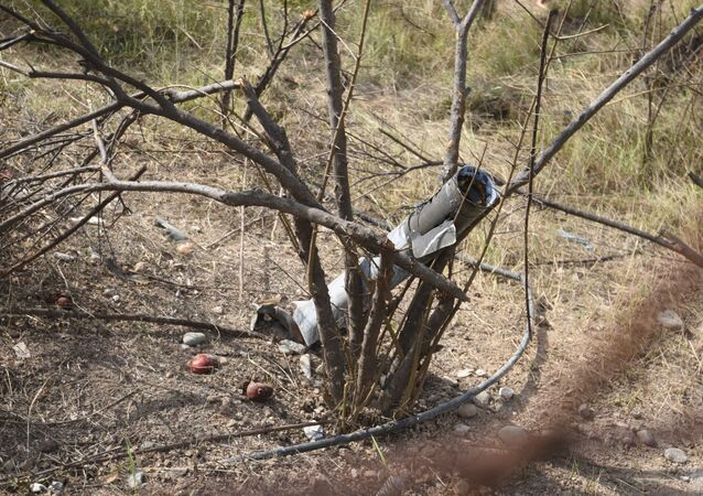 The view shows an unexploded shell stuck in the branches after a recent shelling  in Martakert, a self-proclaimed Republic of the Nagorno-Karabakh