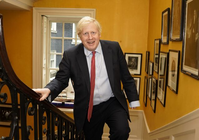 A handout image released by 10 Downing Street, shows Britain's Prime Minister Boris Johnson as he returns from hospital after the birth of his baby son with his partner Carrie Symonds, inside No 10 Downing Street in central London on 29 April 2020.