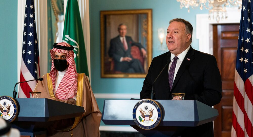 Saudi Minister of Foreign Affairs Prince Faisal bin Farhan Al Saud listens to U.S. Secretary of State Mike Pompeo as he speaks during their meeting at the State Department, in Washington, U.S., October 14, 2020. Manuel Balce Ceneta/Pool via REUTERS