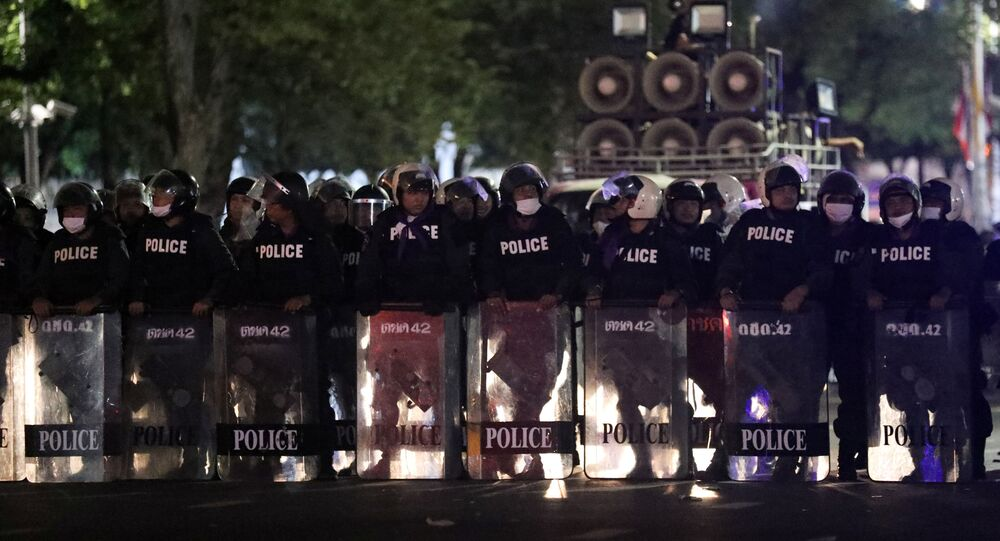 Polices officers take position near Government House during the 47th anniversary of the 1973 student uprising, in Bangkok, Thailand October 15, 2020.