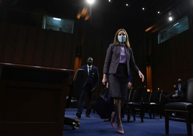 Supreme Court nominee Judge Amy Coney Barrett leaves after testifying on the third day of her confirmation hearing before the Senate Judiciary Committee on Capitol Hill on October 14, 2020 in Washington, DC.