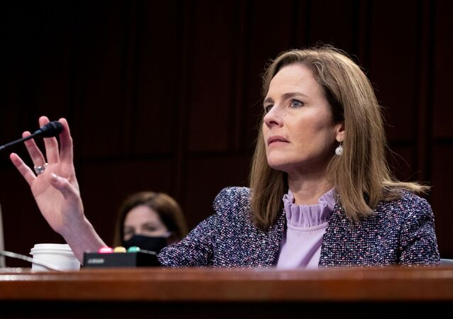 Judge Amy Coney Barrett tests her microphone after it failed several times during the third day of her Senate confirmation hearing to the Supreme Court on Capitol Hill in Washington, DC, U.S., October 14, 2020.