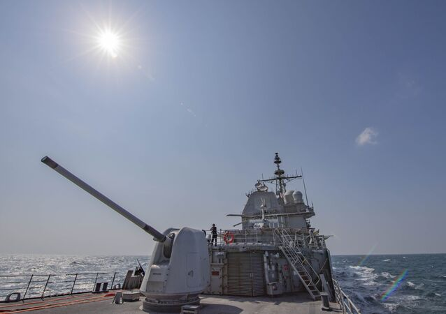 In this Tuesday, Nov. 12, 2019, photo, made available by U.S. Navy, the Ticonderoga-class guided-missile cruiser USS Chancellorsville (CG 62) transits the Taiwan Strait.