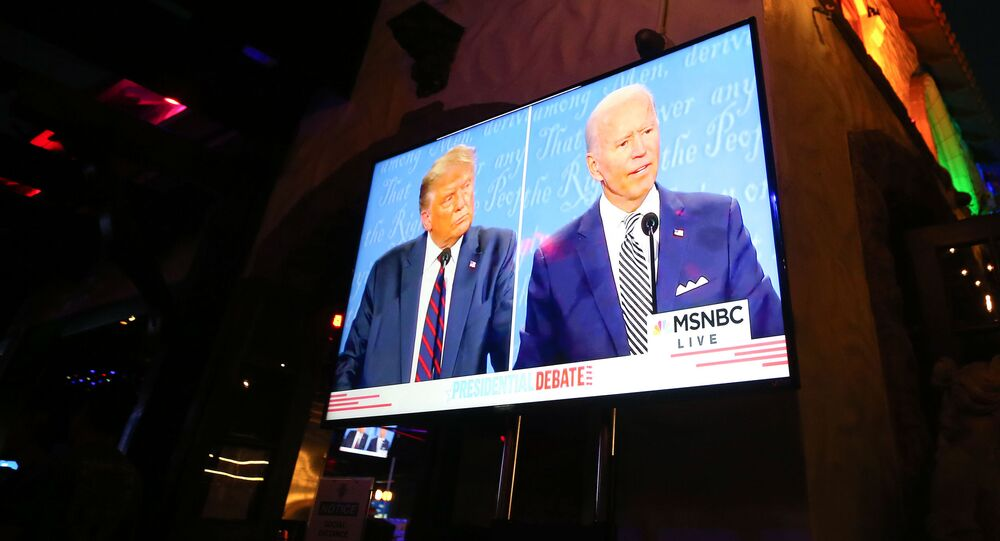 WEST HOLLYWOOD, CALIFORNIA - SEPTEMBER 29: A broadcast of the first debate between President Donald Trump and Democratic presidential nominee Joe Biden is played on a TV at The Abbey, which seated patrons at socially distanced outdoor tables, on September 29, 2020 in West Hollywood, California.