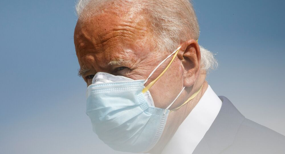 Wearing two protective face masks, U.S. Democratic presidential candidate Joe Biden descends from his campaign plane ahead of a series of campaign events, at the Fort Lauderdale-Hollywood International Airport, in Fort Lauderdale, Florida, U.S., October 13, 2020
