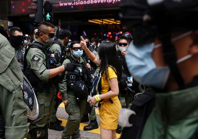 A pro-democracy protester argues with police before a protest urging the release of twelve Hong Kong activists, detained on the Chinese mainland, who were arrested at sea after attempting to flee to Taiwan, on Chinese National Day in Hong Kong, China October 1, 2020.