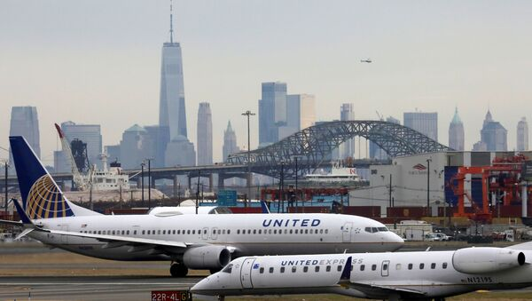 United Airlines passenger jets taxi with New York City as a backdrop, at Newark Liberty International Airport, New Jersey, U.S. December 6, 2019 - Sputnik International