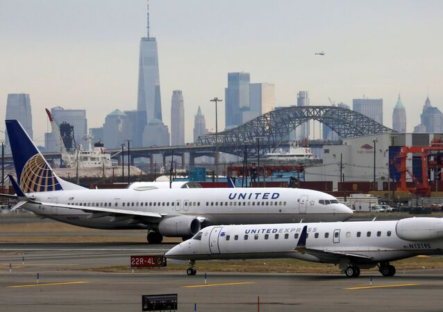 United Airlines passenger jets taxi with New York City as a backdrop, at Newark Liberty International Airport, New Jersey, U.S. December 6, 2019