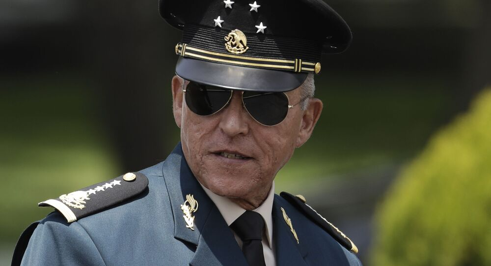 Secretary of Defense Salvador Cienfuegos Zepeda arrives for a review of the troops that will participate in the Independence Day parade, in Mexico City, Wednesday, Sept. 14, 2016.
