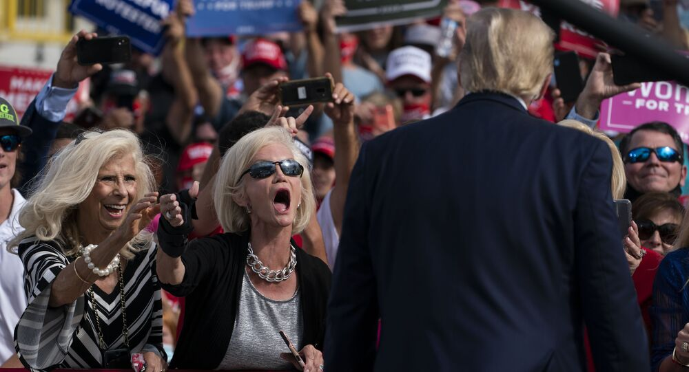 Supporters of President Donald Trump cheer as he walks off stage after speaking at a campaign rally at Pitt-Greenville Airport, Thursday, Oct. 15, 2020, in Greenville, N.C.